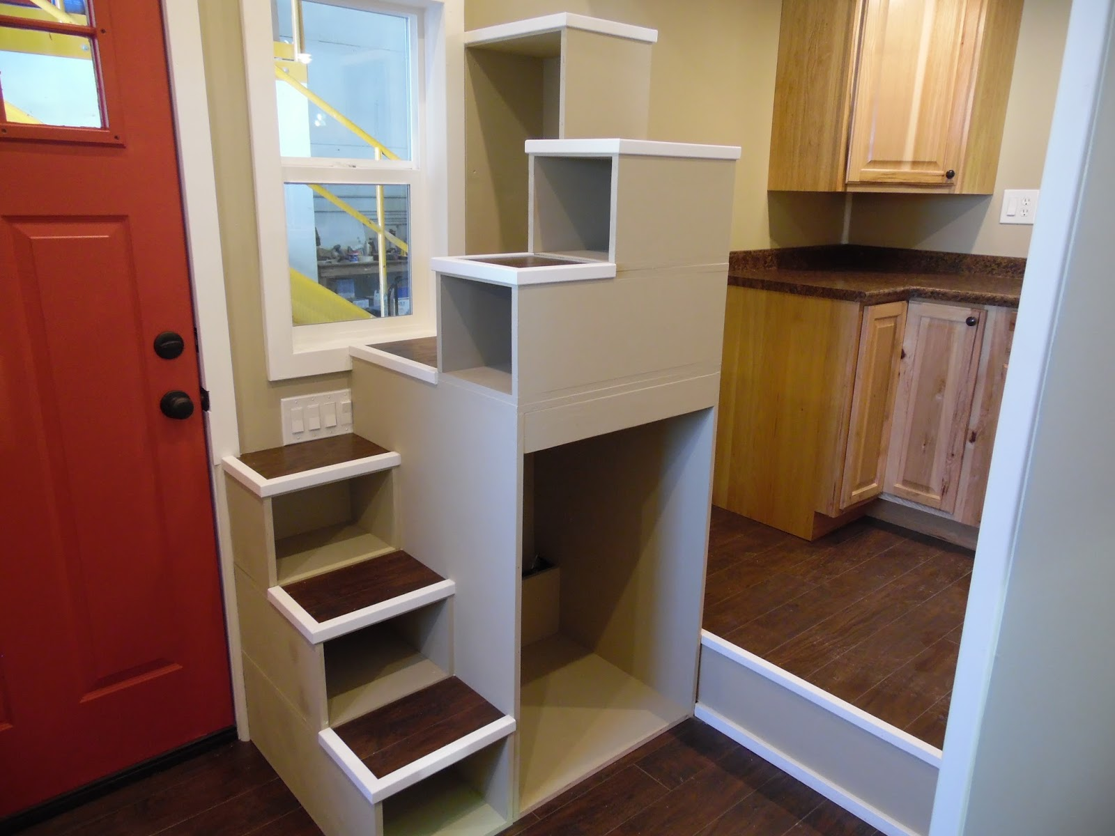 The Birchwood by Upper Valley Tiny Homes stair cabinets